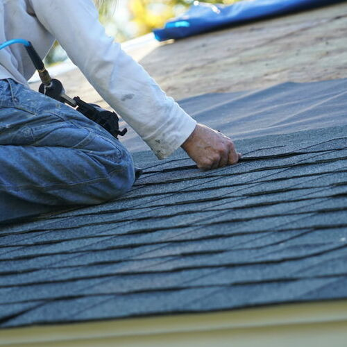 A Roofer Replaces Shingles.