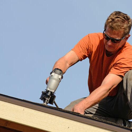 A Roofer Repairs a Roof Leak