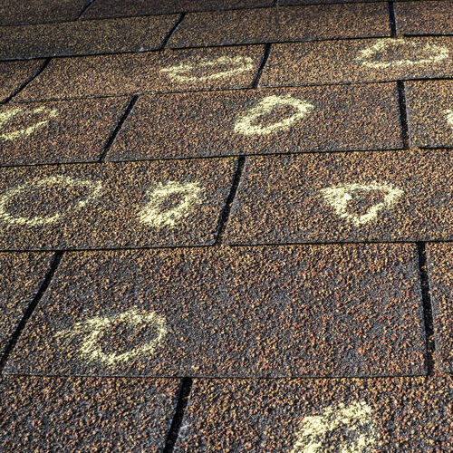 Roof Hail Damage Marked With Chalk.
