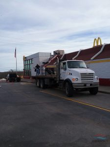 Roofers Unloading Commercial Roofing Materials