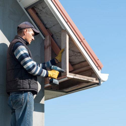 Worker installing a soffit.