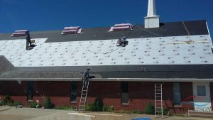 Roofers Installing New Commercial Roofing Materials