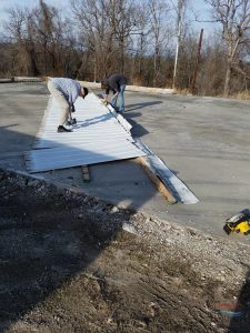 Roofers working on a Standing Seam Metal Roof