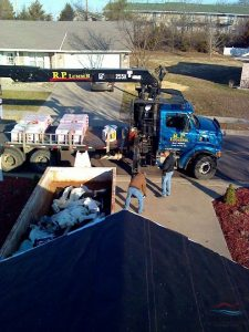 Residential Roofing Project with Material Delivery and a Dumpster.