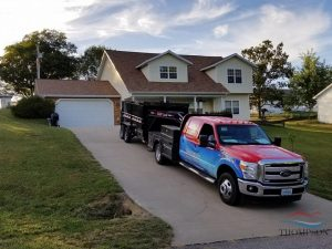Roofing Services Truck Outside a Home